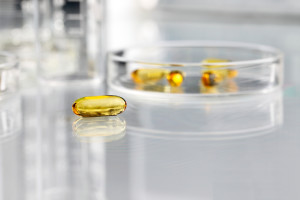 vitamins pills omega 3 supplements with petri dish